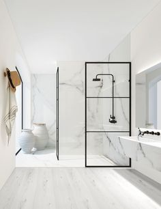 Give your bathroom an urban edge with a crittall-style shower screen. Here are our favourite Crittall-style shower screens in the UK. White Marble Bathrooms, Small Bathroom, Modern Bathrooms, Modern White Bathroom, Bathroom Ideas, Shower Bathroom, Bathroom Remodeling, Bathroom Black, Bathroom Goals
