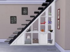 The Shelves under Stair are made by Request and I thought you may like the Deco Spiralstair with Slots too Found in TSR Category 'Sims 4 Decorative Sets'