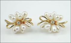 A PAIR OF DIAMOND, CULTURED PEARL, AND 14 KARAT YELLOW GOLD EARRINGS. Lot 150-7298 #jewelry