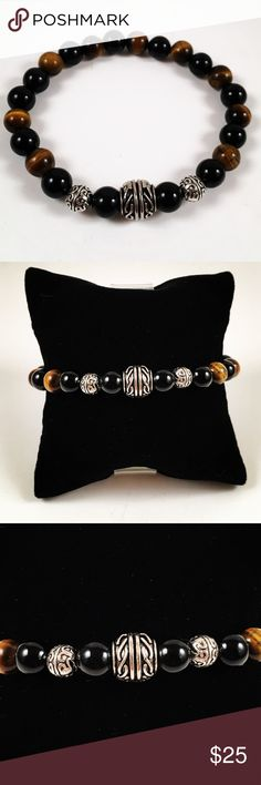 Men onyx and tiger eye beaded bracelet Men beaded bracelet. Fits most , 7.5 to 8.5 inch wrist . Handmade by me , never worn by anyone. Made with onyx and tiger eye beads. Tibetan silver deco charms. I ship fast!!✈️ Accessories Jewelry