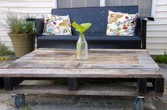 use a pallet and a few castors to make an outdoor coffee table, love the idea! found on  vintage Chica