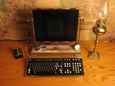 "I'm obsessed with this ""steampunk desktop"" - look at the typewriter keys!!!"