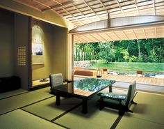 Modern Japanese design dining space with calming garden view. -  赤沢旅館、静岡