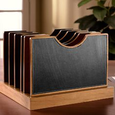 Versatile leather desk organizer  With the removable dividers of our Adjust-A-File desk organizer from the Cubi desk collection, you can give each folder as much (or as little) space as it needs.