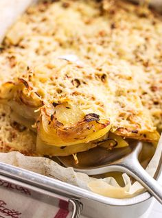 Potatoes, onion, cajun spices and lots of cheese makes this spicy potato casserole a fantastic side dish | eatwell101.com