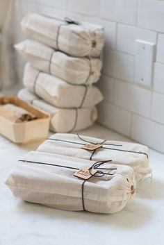 nice idea to interpret for packaging homemade baked goods (cotton drawstring bags + vintage loaf pan + bread + recipe)  || Big Sur Bakery- Holiday Stollen