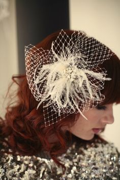 Lo Boheme designer.  6.5 inch bridal fascinator made from Russian veiling and ostrich feathers.  Centered with a vintage inspired rhinestone brooch.