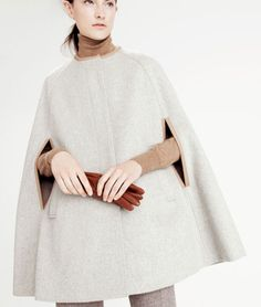 Design Chic - love the tan turtleneck with the off white cape