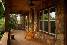 Front porch with swing and rocker-one of many - Fort Gibson Lake lodge rental