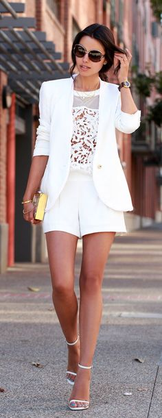 Annabelle Fleure is wearing white shorts from Trina Turk, lace top from Cameo, clutch from Thale Blanc, blazer from Helmut Lang and the shoes are from Saint Laurent