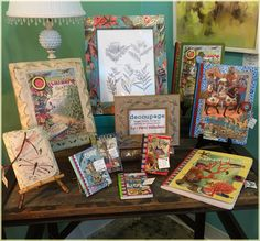 A More Than Fine Framing display of decoupage journals, frames and plaques currently in stock. We got to get cutting and gluing and make more!