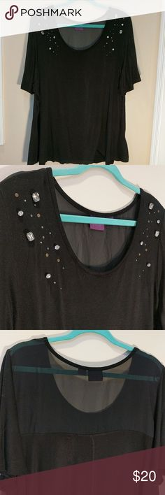 Black dressy top with beads Dressy black top with sheer upper back and faux diamonds on front. Lower part of shirt full for flattering fit. Rayon, spandex mix. Feels like very soft tshirt. Sheer part is polyester Beverly Drive Tops Blouses