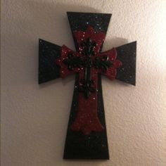 A big cross I made for the wall. I bought two wooden crosses and an iron cross. I painted the two and sprinkled it with glitter. It's much brighter and prettier in person!