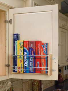 Because they don't fit in any drawers or cabinets, use metal rack inserts in your cabinets to store those oddly shaped boxes.