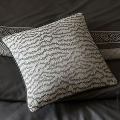 Morra Decorative Pillow: To add a pop of bold graphic texture to your decor, we suggest the distinguished Morra decorative pillow by Sferra. With an ikat-type allover pattern, its silver-hued accent colors, and its custom-made trim, Morra makes an easy addition to any room.