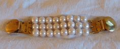 A personal favorite from my Etsy shop https://www.etsy.com/listing/541540173/vintage-pearl-sweater-clip-three-strand