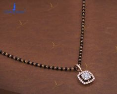 Jewelry OFF! Enchanting Mangalsutra Designs Which Are Steal Worthy! Diamond Mangalsutra, Gold Mangalsutra Designs, Gold Earrings Designs, Gold Jewellery Design, Mangalsutra Simple, Indian Gold Necklace Designs, Beaded Jewelry, Jewelry Box, Jewelry Scale