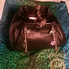Versace for H&M handbag Never used.  Limited edition Versace  Leather handbag with gold tone fun charms & chain link handle. Versace dustbag included Versace Bags Satchels