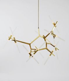 Roll & Hill designer Lindsey Adams Adelman combines hand-crafted and machine-made techniques to create the Agnes Chandelier. Personalize this bold statement piece by rotating the bulbs at irregular angles to fill your space.