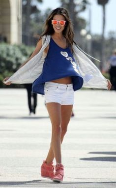 I want her sneaker wedge style! And her wayfarer pink shades lol