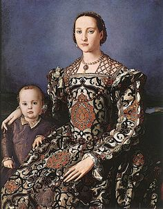 This 1550 Bronzino painting shows Eleonora de Toledo gorgeously dressed wearing a pomegranate print with a jeweled headdress and a jeweled reticulated partlet. She is with with her son Giovanni. She had six children who lived to adulthood. Giovanni became a cardinal.