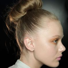 An oversized chignon, as seen at Donna Karan AW11, is a great evening style. Perfect for a wedding too, get the style right and it'll stay in place all night.