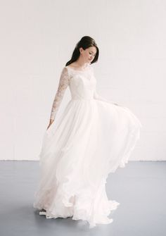 1fb5a78c28a Naomi Neoh  Theia  - silk pink chiffon gown with handkerchief skirt and  long sleeved lace jacket. Alison Kirk Bridal