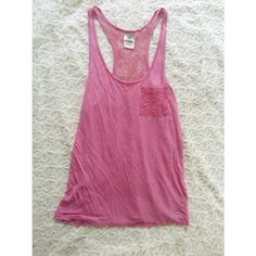{victoria's secret PINK} lace tank Cute hot pink racerback tank. Lace back and a lace pocket on front with a little plaque on the bottom saying PINK.   Worn with pilling and has one tiny hole on the neckline which is not too noticeable. Reflected in price.   Size small.   50% rayon 35% modal and 15% cotton PINK Victoria's Secret Tops Tank Tops