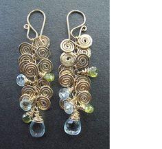 Venus 110 Hammered swirls earrings.