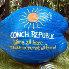 """Conch Republic: We're all here 'cause we're not all there!"" painted coconut in Key West, FL (needs another apostrophe!)"