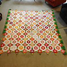 I had to bring it to Mum's so that I could lay it out on the floor. I'm still working on the outer borders, but this is how my #zestyhexies quilt top is looking. #hexies Queen size.
