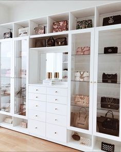 Custom Closets Greater New York This jaw-dropping bag closet was created for beauty influencer, Amra Olevic. The storage designed by California Closets New York designer , Allegra Pennisi entails a perfect boutique display and offers a ready-to-use option Walk In Closet Design, Bedroom Closet Design, Closet Designs, Bedroom Wall, Bedroom Decor, Walking Closet, Bag Closet, Bed In Closet, White Closet