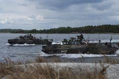 160611-N-YM856-009 UTO, Sweden (June 11, 2016) Swedish Marines with 1st Marine Regiment prepare to come ashore during the tactical exercise phase of BALTOPS 2016. BALTOPS is an annual recurring multinational exercise designed to improve interoperability, enhance flexibility, and demonstrate the resolve of allied and partner nations to defend the Baltic region. (U.S. Navy photo by Mass Communication Specialist 2nd Class Brittney Cannady/Released)