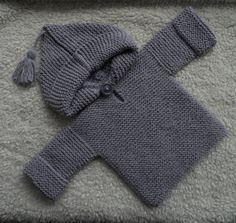 An all cotton hooded jumper for your baby boy or girl! Suitable for winter or summer as the stitch I used to knit it gives a thick springy texture.  The yarn I chose is a nice chalky lilac shade and 100% cotton - soft and gentle on babys skin. The seams are mostly stitched flat to eliminate bulkiness especially around the sleeve tops, only the hood has a slight ridge to it.  Its a simple pull on style with a single chunky button to fasten and the hood is finished with a cheeky tassel…