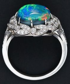 Under view: Fire opal and diamond ring. Via Diamonds in the Library.