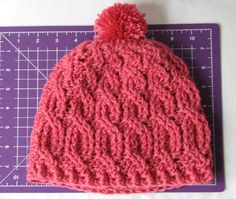 Cable Crochet Beanie with Pom Pom (click on Miss Knittles) for free pattern