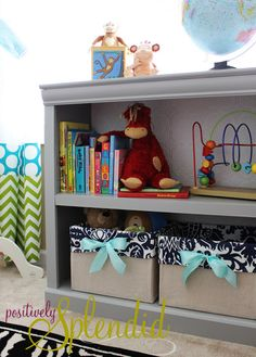 Would you believe that these lovely custom canvas bins are actually dressed up diaper boxes? What a brilliant idea!