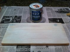 The primer coat, put down and then dry brushed to remove some of the primer to let the wood show through a bit.