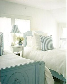 painted antique twin beds, white vintage linens, blue and white stripe accent fabric.  cottage style