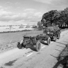 ARTY British Morris Quad vehicle towing an Ordnance QF 4.5 inch Howitzer of 51st Highland Division on the Huntly-Turniff road in Banffshire, Scotland, United Kingdom, 10 Oct 1940