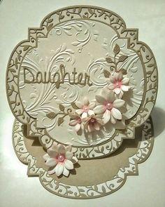 Handmade easal  card using Tonic twisted veranda dies and Sara Davies signature floral dies.