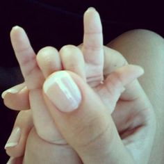 adorable baby and mom fingers