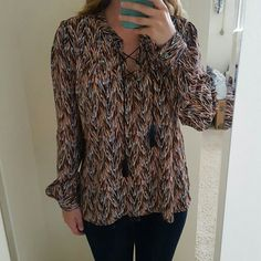 Brand New Flowy Long Sleeve Blouse Gorgeous long sleeve blouse. Great for interviews or a night out. The shirt does hang a little lower in the back than it does the front. Has great cross front ties as shown in photos. Brand new with out tags. Make me an offer :) Xhilaration Tops Blouses