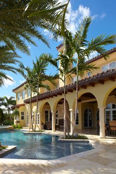 spanish tile roof, pool close to house