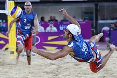 Phil Dalhausser (l.) of US looks on as his teammate Todd Rogers dives for a ball during their Beach Volleyball match against Japan at the 2012 Summer Olympics.