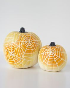 Skip the mess of carving and go for this elegant spider-inspired alternative: ombre-painted pumpkins. This spooky project requires only five basic materials.