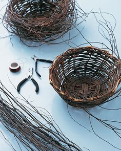 Start with a wooden basket that is 8 or 12 inches in diameter. Gather a bundle of birch branches. Cut off the fine tips, then cut the branches into varying lengths (6 to 12 inches).  Using 24-gauge brown wire, secure the end of a branch to the base of the basket. Bend the branch along the basket's curve, wiring every 4 or 5 inches so that loose ends stick out. Repeat with remaining branches, overlapping them to conceal the basket.