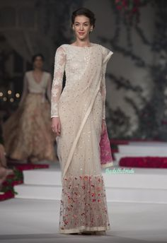 off white net saree with sequins and a floral embroidered wide border and ivory embroidered boat neck blouse with sheer long sleeves. Varun Bahl Amazon India Couture Week-2015