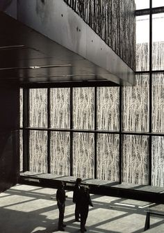 jungle trees printed on glass and carved into black concrete | Utrecht University Library | Wiel Arets