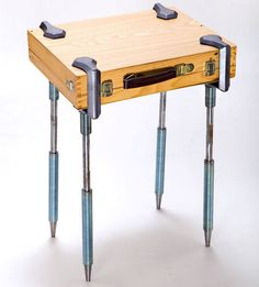 C-clamp legs can turn anything into a table. Suitcase... book... canvas...